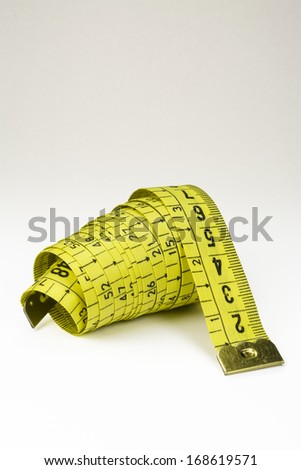 Yellow Measuring Tape on White Background Photo (with clipping path) - stock photo
