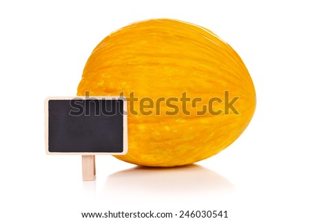 Yellow melon with empty little blackboard, concept - stock photo