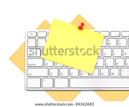 Yellow memo on white keyboard - stock photo