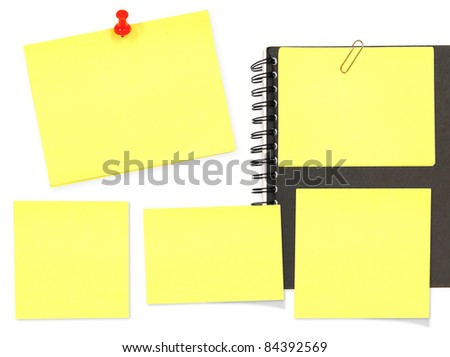 Yellow memo stick and notebook on white background - stock photo