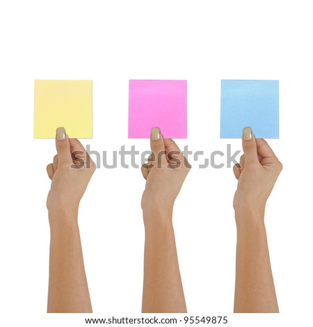 Yellow memo stick on women hand on isolated background