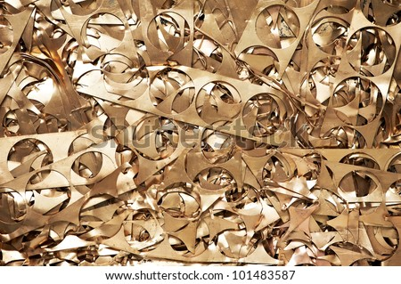Yellow metal brass scrap materials recycling backround of punching waste