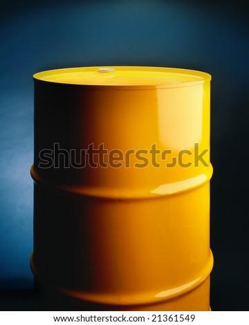Yellow metal drum on seamless background - stock photo