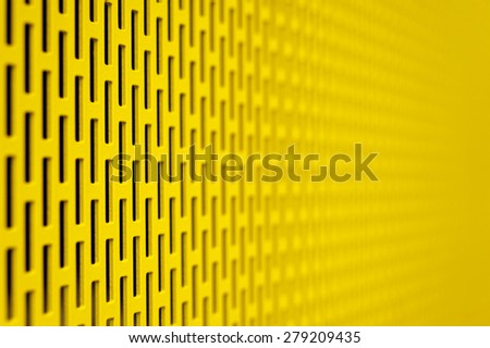 Yellow metal grid in small depth of focus - stock photo