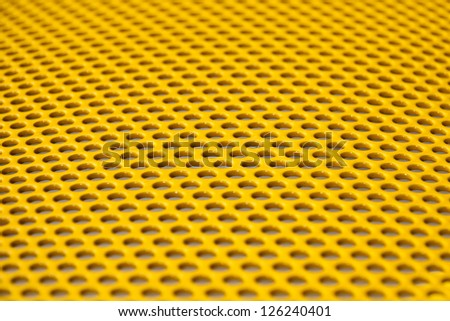 Yellow metal grille from gym equipment - stock photo