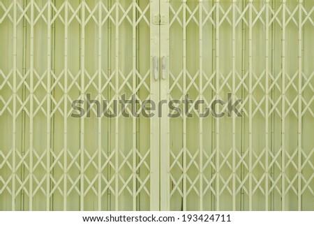Yellow metal grille sliding door - stock photo