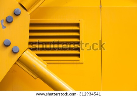 Yellow Metal Machine Part for background - stock photo