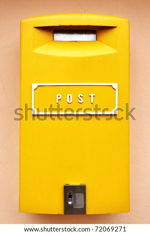 Yellow metal mail box close up - stock photo