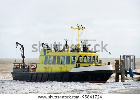 Yellow metal ship in ice
