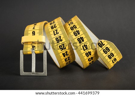 Yellow meter belt slimming on a black