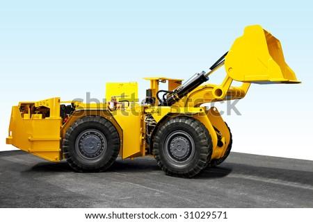 Yellow mining digger for underground hard work - stock photo
