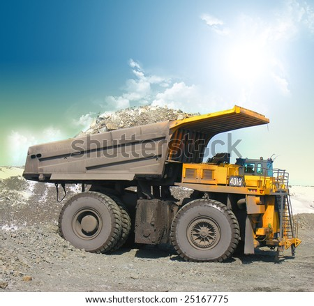 Yellow mining trucks - stock photo