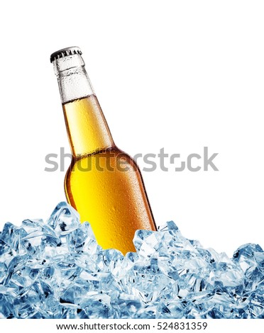 Yellow misted over bottle of the beer on ice isolated on white background