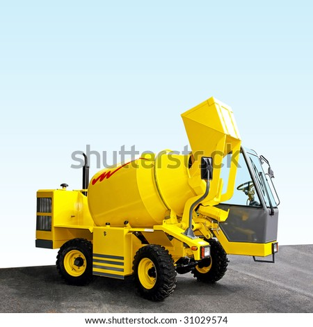 Yellow mobile cement mixer with diesel engine - stock photo