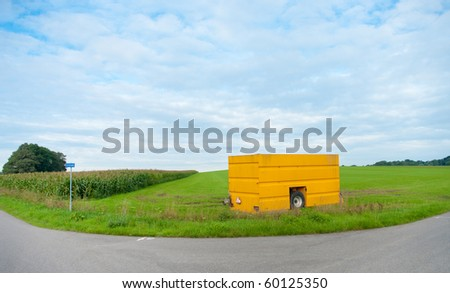 yellow mobile silo for liquid manure
