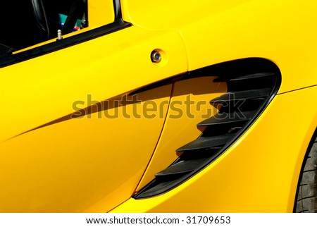Yellow modern sportscar - stock photo