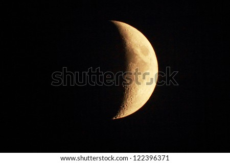 yellow moon in a clear night sky - stock photo