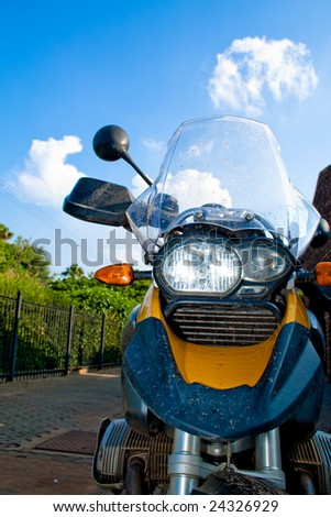 Yellow motorbike with headlight on
