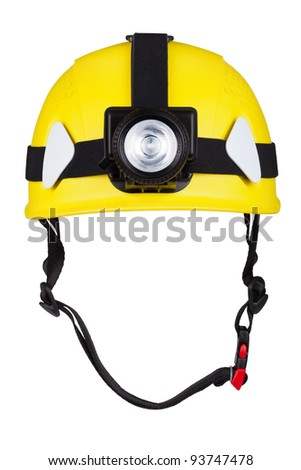 yellow mountain helmet with headlamp - stock photo