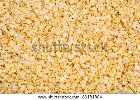 Yellow movie style popcorn background - stock photo