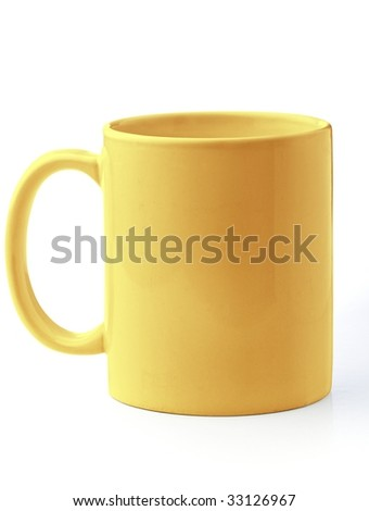 Yellow mug - stock photo