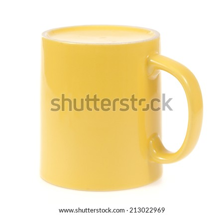 Yellow mug cup for coffee tea water on white background - stock photo