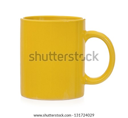Yellow mug for coffee or tea, isolated on white background - stock photo