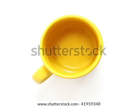Yellow mug, the top view, isolated on white background - stock photo