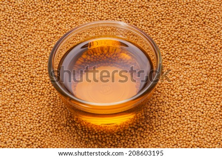 Yellow Mustard Seeds and oil  - stock photo