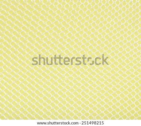 Yellow net sponge texture background - stock photo
