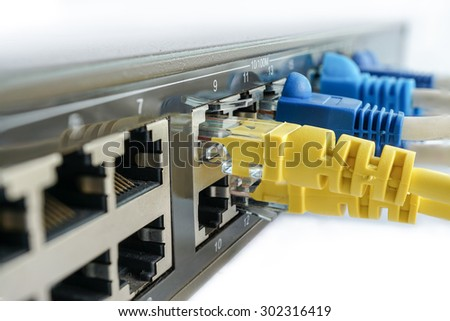 yellow network cable connect to switching hub, closed up network connector - stock photo