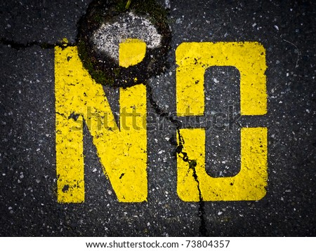 "Yellow ""No"" sign painted on asphalt - stock photo"