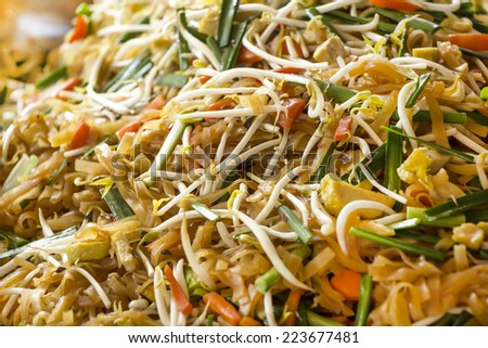 Yellow noodle fried with vegetables and tofu. Chinese food for Vegetarian Festival. - stock photo