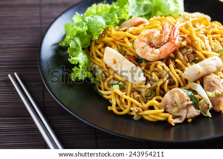 yellow noodle stir-fired with shrimp and meat - stock photo
