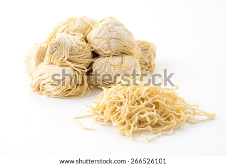 yellow noodles on white background - stock photo