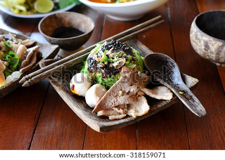 Yellow noodles served �¢??dry�¢?�, thai food (Style Still Life) - stock photo