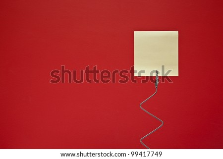 Yellow note on red background - stock photo