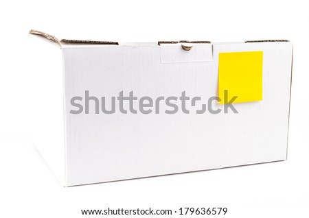 Yellow note on white box on isolated white background - stock photo
