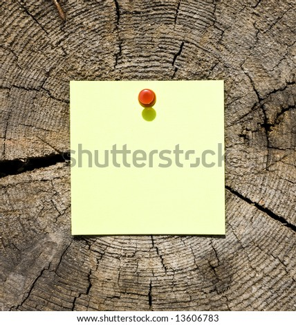 Yellow Note On Wooden Background - stock photo