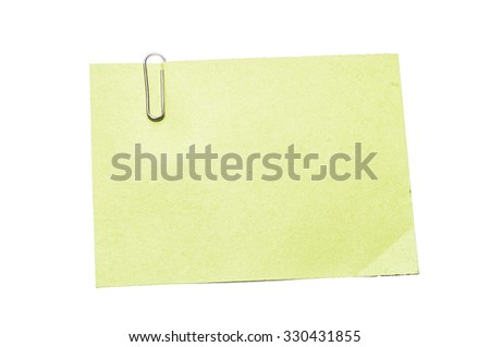 Yellow note paper with paper clip on white background, Isolated