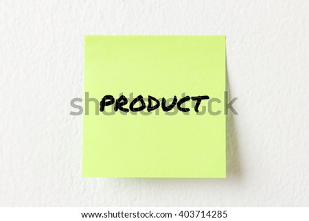 Yellow note paper with words Product on the white wall