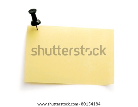 yellow note with black pin over white background - stock photo