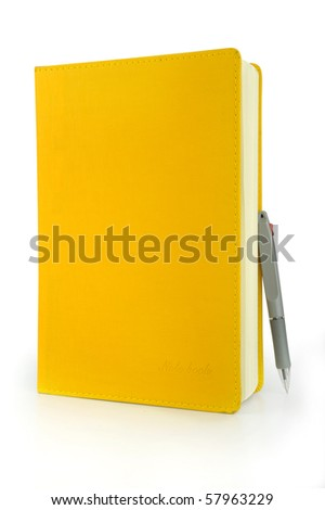 Yellow notebook and pen in the White background - stock photo