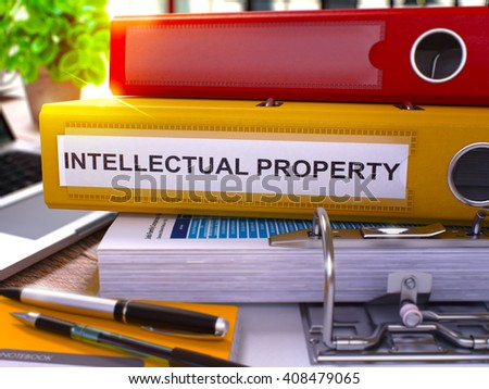 Yellow Office Folder with Inscription Intellectual Property on Office Desktop with Office Supplies and Modern Laptop. Intellectual Property Business Concept on Blurred Background. 3D Render. - stock photo