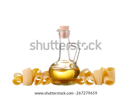 yellow oil in a bottle with pasta - stock photo