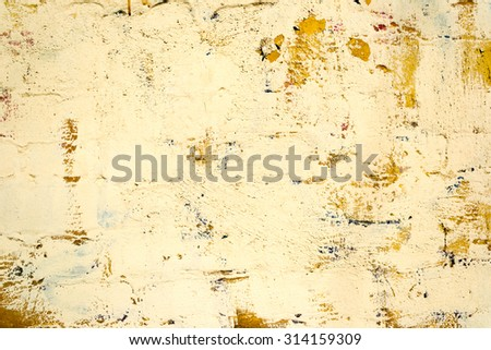 Yellow old dirty concrete wall texture or background - stock photo