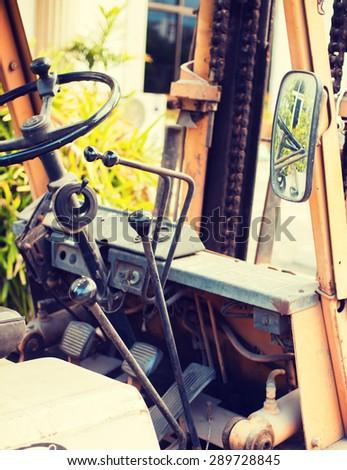 Yellow old folk lift truck - Instagram filter - stock photo