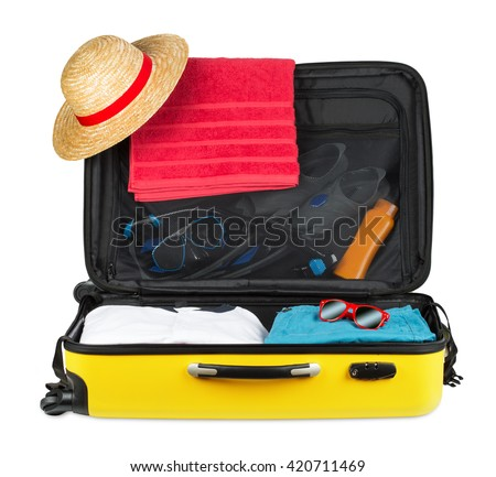 yellow open packed suitcase isolated on white background