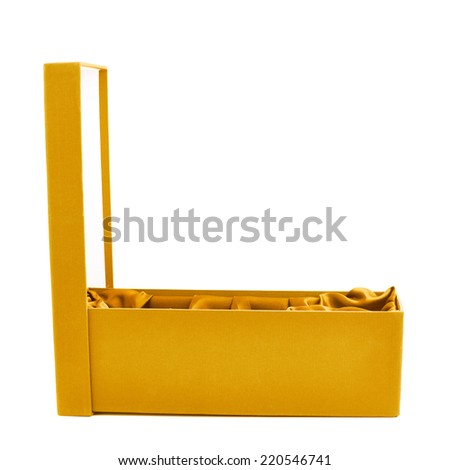 Yellow opened tall gift box with the velvet cloth inside, isolated over the white background - stock photo