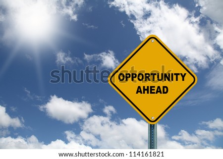 Yellow opportunity ahead road sign - stock photo